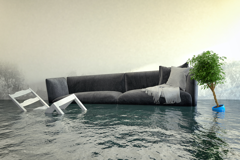 Water damager after flooding in house with furniture floating.